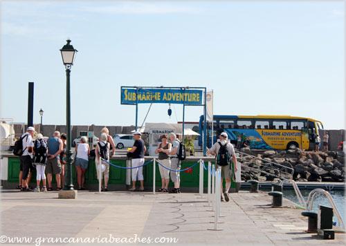 Tourist waiting for bus in Mogan, Gran Canaria